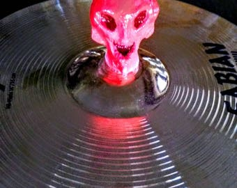 Includes 2 items-Alien Cymbal Stand Topper + Neon Red Drumsticks