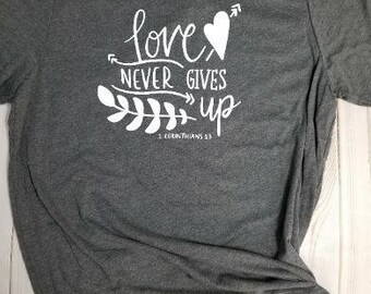 T-shirt- Love never gives up! Choose your own color!