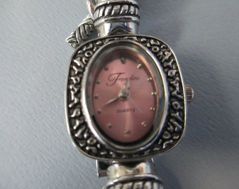 """Vintage lady's watch from """"Fontini""""  antiqued silver linked band with pink face and glass beads toggle closure  used watch"""
