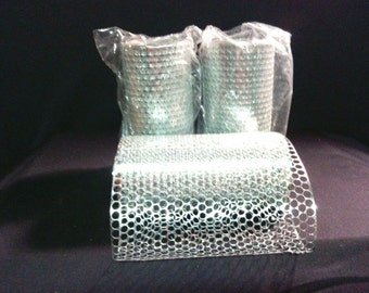 50 yrds of Puchinella/honeycomb Silver Metallic
