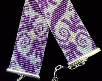 Purple swirls bead-woven bracelet