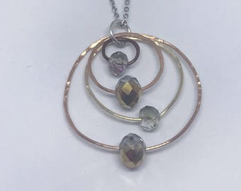 Beautiful hammered wire and crystal silver and rose gold pendant