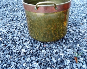 Hammered or hand-hammered yellow copper-brass bowl with yellow copper handles, rustic interior