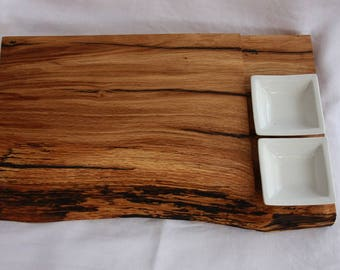 Chopping board in solid oak wood with bowls for sauces