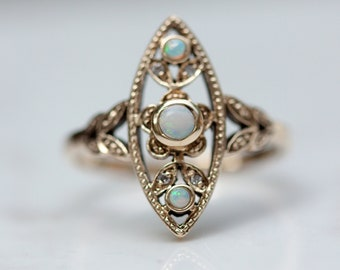 Vintage Midcentury Navette Style Opal and Diamond Ring set in Solid 14k Yellow Gold, Size 6.75