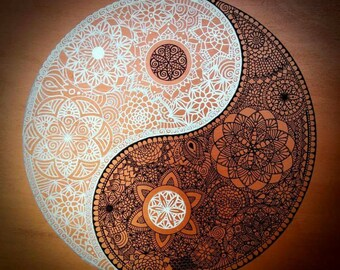 Drawing of Yin and Yang on a wood