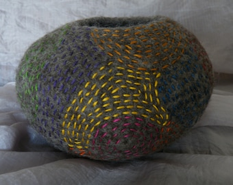 Soft pot shaped hand felted vessel, decorated with multi coloured stitching