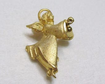 vintage 1970s gold toned metal angel with bell brooch pin