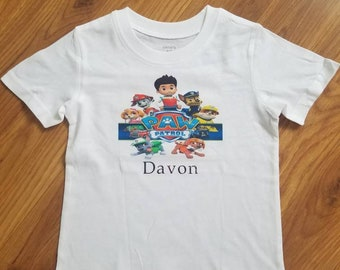 Personalized Paw patrol t-shirt with all the characters and trucks.