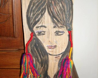 Portrait of woman on wood Board