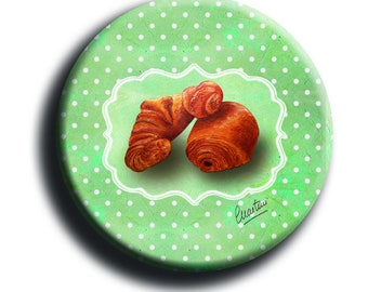 Magnet magnet depicting a Crescent and a chocolate bread on a green background with white dots in 38 mm