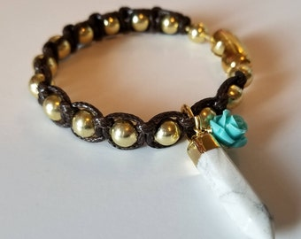 Gold and turquoise knit bracelet.