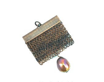 brown-black mottled finger knitted pendant with a fresh water pearl