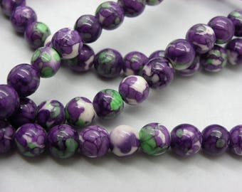 63 jade beads 7 mm white colored original drawings has purple, blue, green, white 1 strand