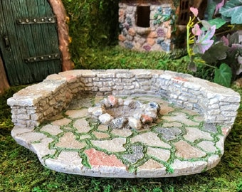 Miniature Stone Patio with a Wall and a Fire Pit