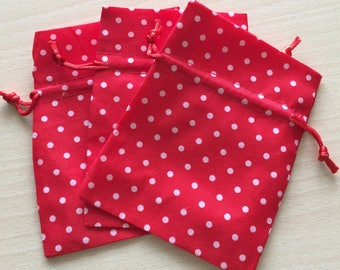 Red fabric with white polka dots pouch size 9 x 12 cm