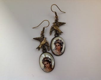 Pendant has antique bronze earrings