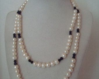 Vintage 34 inch strand of pearls separated by black jet