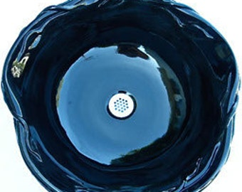 Pure Black Vessel Sink with Vining Leaf Rim adds sophistication to your home.