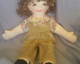 15 inch cloth (rag) doll, with hair and eyes of your choice, comes dressed in tan corduroy overalls and matching shirt