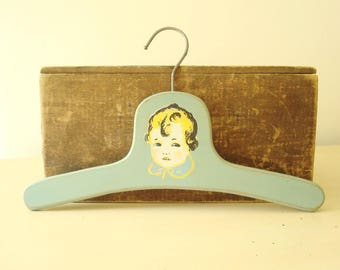 Child's clothes hanger, vintage aqua baby hanger with decal of a blond baby, mid-century children's decor, cottage style, shabby decor