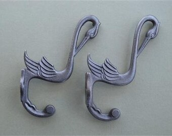 A pair of beautiful Arts and Crafts style cast iron stork hooks