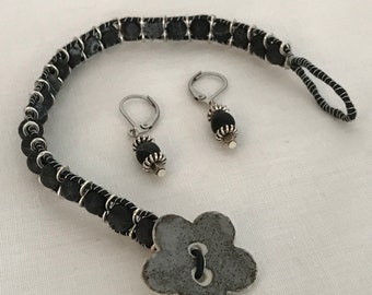 Wire wrapped bracelet with little black earrings