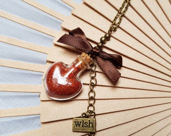 Red Heart Shaped Mini Bottle Necklace With Bronze color Bow