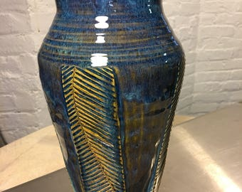 Large thrown and carved vase.