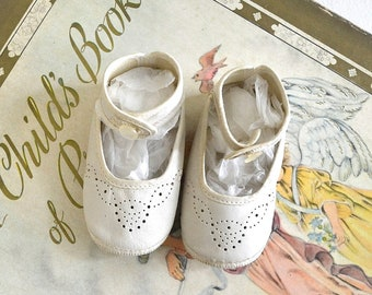 vintage baby girl's white leather shoes
