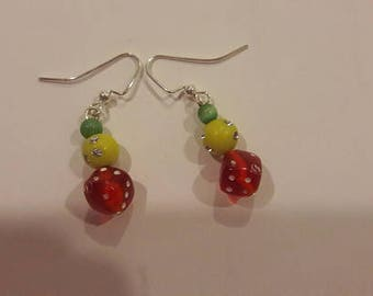 Red dice with yellow and green beads