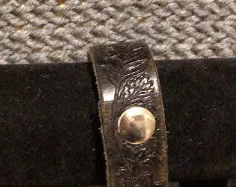 Leather embossed recycled cuff bracelet .