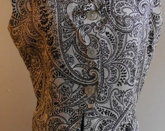"1950's, 38"" bust, cotton pique blouse,  with black and white paisley pattern."