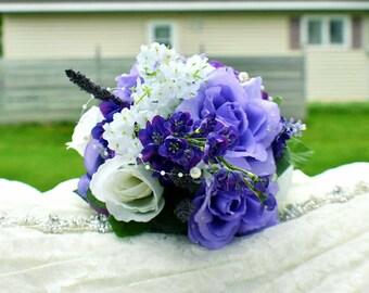 Silk bridal bouquet, purple tones, floral arrangements.