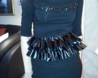 Black ruffled belt, (The Bustle) , comes in S-M. M-L.