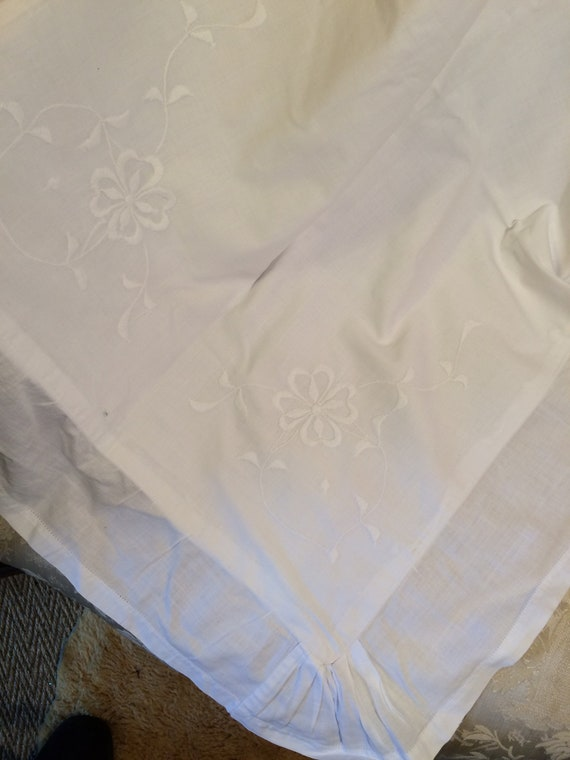Embroidered 1950's frilled pillowcase. 32x24 ins. Good. Strong