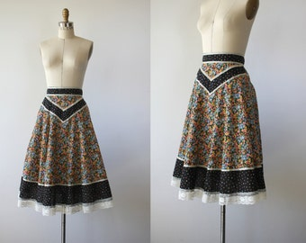 vintage 1970s skirt / 70s boho prairie skirt / 70s black and floral skirt / 70s festival skirt / size small 26in waist