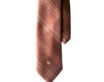Luxurious vintage 80s dark brown polyester neck tie with light blue and white thin stripes and Logo Dior. Made By Christian Dior in USA.
