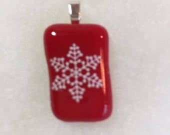 Fused glass pendant: white snowflake on red glass