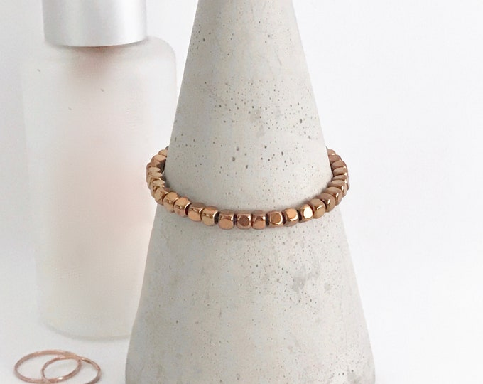 QUINSCO - Small Bronze/Copper Hematite Bead Stretch Bracelet