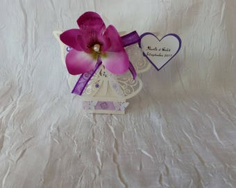 Box has favours butterfly and flower Orchid purple