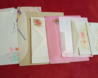 7 sets of vintage writing paper and envelops