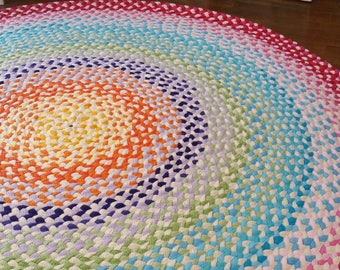 """58"""" braided rug created from recycled t shirts and some new t shirt fabric"""