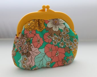 Yellow clutch with pink flowers and hot pink frame