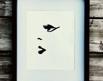 Le visage Black marker drawing on a pearl colored paper