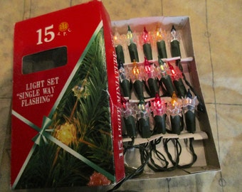 vintage 15 light strand of electric lights - new old stock, in box, unused, flashing