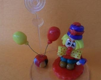 Clown wears photo or cake topper of cold porcelain