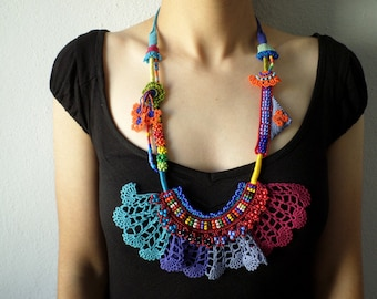beaded statement necklace - with orange, red, pink, blue and green beaded flowers and crochet lace
