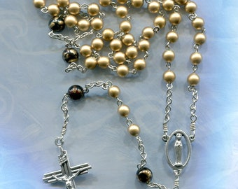 Burnished gold 6mm Ave beads with 8 mm black/gold Pater beads 5 decade chain rosary