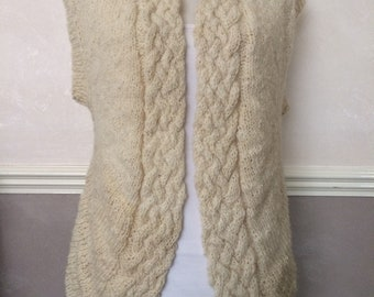 Hand knitted sleeveless cardigan made using Hand-spun wool, with cabled edge detail